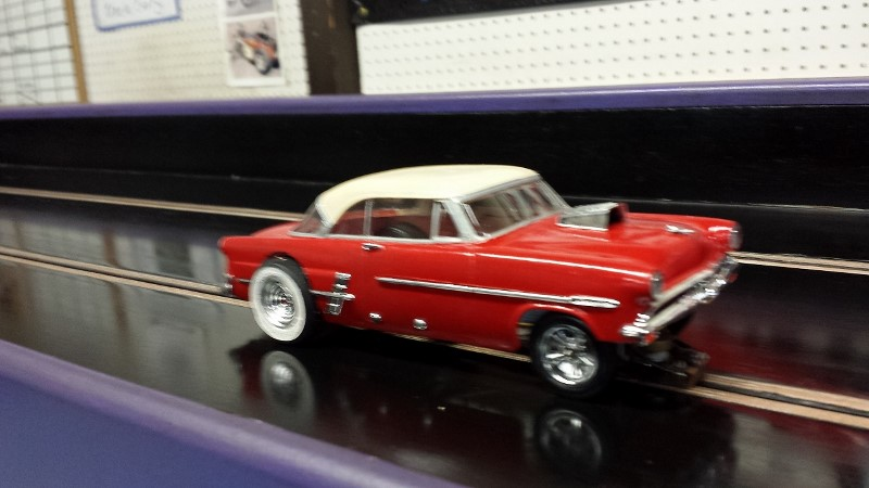 Johnny MAC red and white '53 ford G Gas on track (800x450).jpg